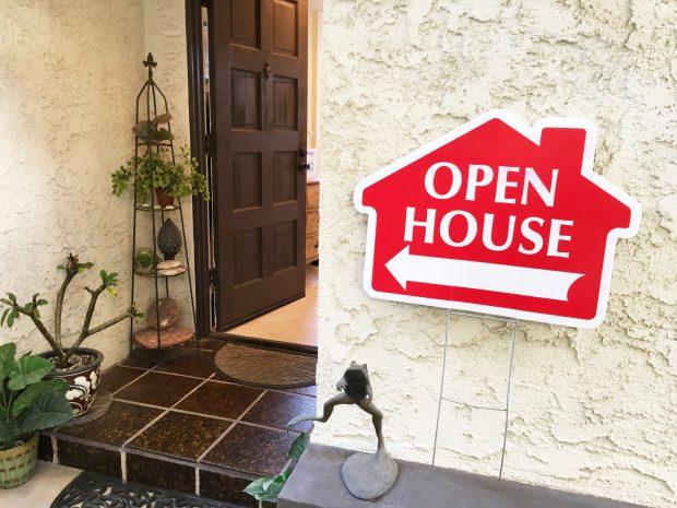 open house sign in front of an open door